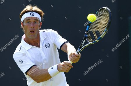 Daniel Gimeno-Traver of Spain in action at Wimbledon, 2015