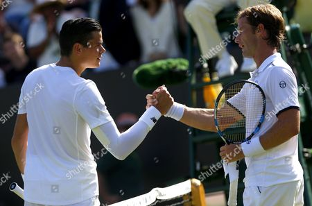 Milos Raonic of Canada shakes hands with Daniel Gimeno Traver of Spain at Wimbledon, 2015