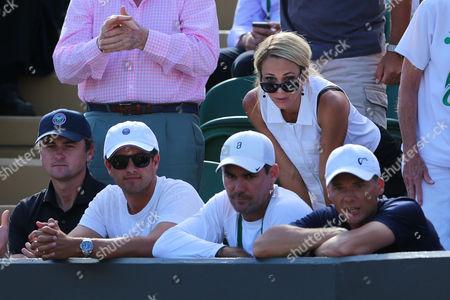 "Lleyton Hewitt 's wife  Rebecca June ""Bec"" Hewitt (in shades) watches her husband's final singles' Wimbledon match with the coaching team"