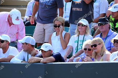 "Lleyton Hewitt 's wife  Rebecca June ""Bec"" Hewitt (holding shades) watches her husband's final singles' Wimbledon match with the coaching team"