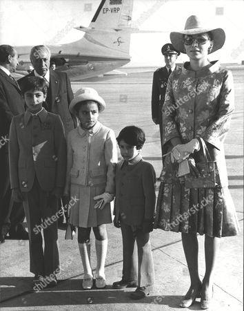 The Empress Farah Of Iran With Their Children At Shiraz Airport; Princess Farahnaz Pahlavi (8) Crown Prince Reza Pahlavi (11) And Prince Ali Reza Pahlavi (5). Box 0591 22062015 00423a.jpg.