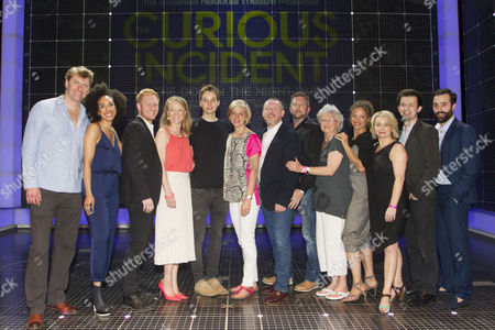 Stock Picture of Stephen Beckett (Roger Shears), Pearl Mackie (No 40/Punk Girl), Matthew Trevannion (Mr Thompson), Mary Stockley (Judy), Sion Daniel Young (Christopher Boone), Marianne Elliott (Director), Sean McKenzie (Reverend Peters), Jacqueline Clarke (Mrs Alexander), Indra Ove (Mrs Shears), Rebecca Lacey (Siobhan), Kaffe Keating (Alternate Christopher) and Simon Victor (Understudy Roger Shears) backstage after the curtain call