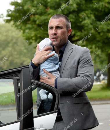 Greg Wood as Trevor Royale, with baby