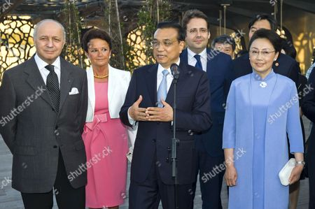 Stock Image of Chinese Prime Minister Li Keqiang and French Foreign minister Laurent Fabius Minister of Foreign Affairs and International Development accompanied by his wife Francoise Castro and the mayor of Marseille attend a business meeting at the Mucem in Marseille