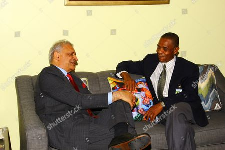 The Commonwealth Sec. General Kamalesh Sharma seated in the VIP Lounge chatting with the Chief of Protocol Mr Philip St.Hill