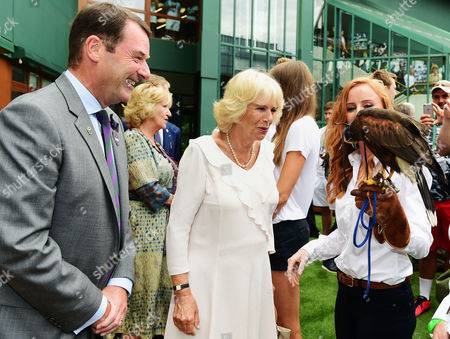 Chairman Philip Brook and Camilla Duchess of Cornwall meet Imogen Davis (right) and hawk Rufus during a visit to the the Lawn Tennis championships at the All England Lawn Tennis Club