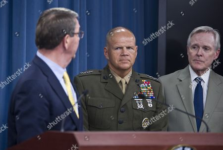 Lt. General Robert B. Neller (center) is announced as the nominee for the US Marine Corps Commandant by Secretary of Defense Ashton Carter (L), Secretary of the US Navy, Ray Mabus is on the right.