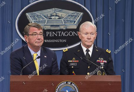 US Secretary of Defense, Ashton Carter (suit) and General Martin Dempsey, Chairman of the Joint Chiefs of Staff brief Pentagon reporters and announce the new commandant of the US Marine Corps.