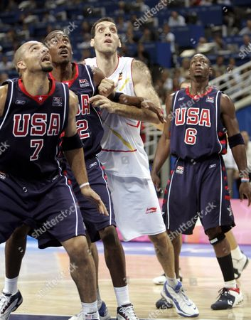Basketball - Spain vs USA: Spain's Roberto Duenas views the rebound with US Carlos Boozer (L), Amare Stoudamire (12) and Dwyane Wade Jr (6) during their men's quarter final game