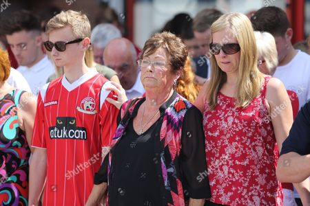 Suzy Richards (left), wife to Charles 'Pat' Evans, with son Owen Richards who survived the shooting, and her daughter