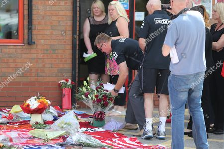 Walsall manager Dean Smith lays flowers