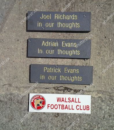 Plaques outside the football ground bearing the names of Joel Richards, Adrian Evans and Patrick Evans