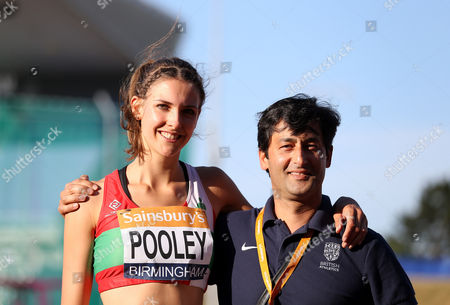 Great Britain Isobel Pooley  and her coach Fayyaz Ahmed after winning the Women's High Jump