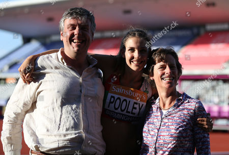 Great Britain Isobel Pooley with her parent after winning the Women's High Jump
