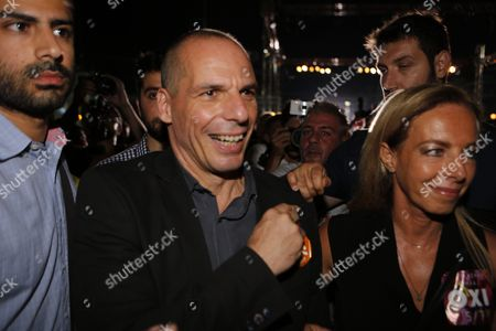 Greek Finance Minister Yanis Varoufakis (centre) and his wife Danae Stratou (right) make a walkabout after the 'No' vote rally