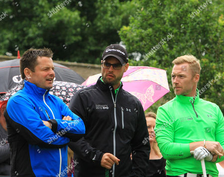 Chris Hollins chats with Keith Duffy and Ronan Keating of Ireland at the third tee