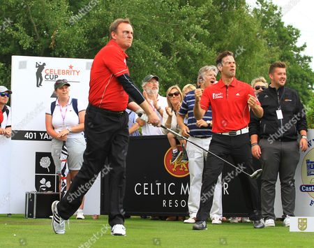 Phillip Glenister of Wales is cheered on by Gethin Jones on the first hole