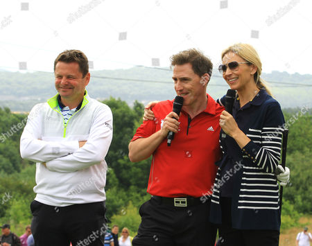 Chris Hollins(L), Rob Brydon and Di Dougherty entertain the crowds on the first tee