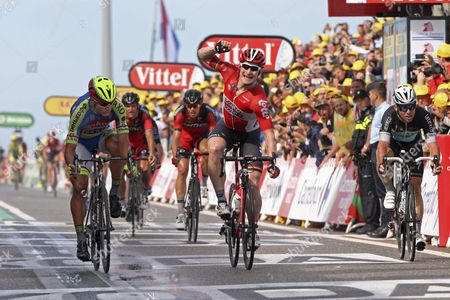 Andre Greipel (Ger) in red beats Peter Sagan (Yellow Helmet) and Fabien Cancellara (Far Left) 3rd and Mark Cavendish 4th on the right. This finish is on North Sea Barrier. Cancellara takes over the yellow jersey because of a time bonus for 3rd