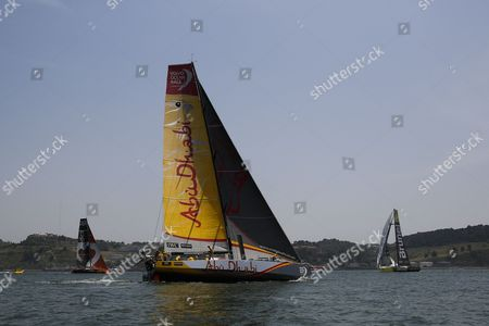 Abu Dhabi Ocean Racing team, skippered by Ian Walker from United Kingdom, Alvimedica team skippered by Charlie Enright from United States and Brunel team skippered by Bouwe Bekking from Netherlands, sail down the Tagus River, in the Oeiras In-Port Race in Lisbon on June 6, 2015, on the eve of Leg 8 between Lisbon and Loirent, France.