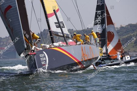 Abu Dhabi Ocean Racing team, skippered by Ian Walker from United Kingdom and Alvimedica team skippered by Charlie Enright from United States, sail down the Tagus River, in the Oeiras In-Port Race in Lisbon on June 6, 2015, on the eve of Leg 8 between Lisbon and Loirent, France.