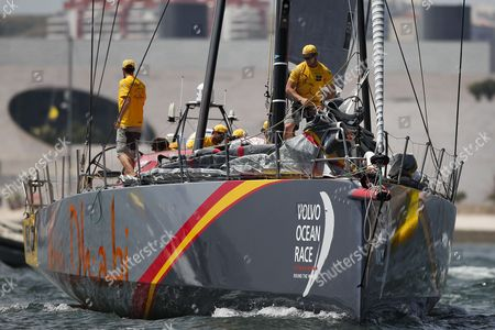 Abu Dhabi Ocean Racing team, skippered by Ian Walker from United Kingdom, sails down the Tagus River, in the Oeiras In-Port Race in Lisbon on June 6, 2015, on the eve of Leg 8 between Lisbon and Loirent, France.
