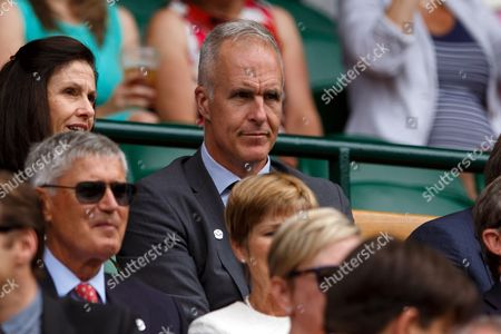 Former player Todd Martin watches from the royal box