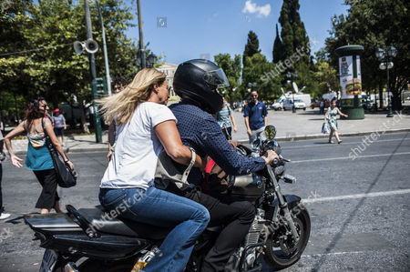 Yanis Varoufakis after his resignation, leaving the ministry on his motorcycle with wife Danae Stratou