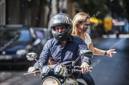 Yanis Varoufakis after his resignation, on his motorcycle with wife Danae Stratou after he leaves a bar
