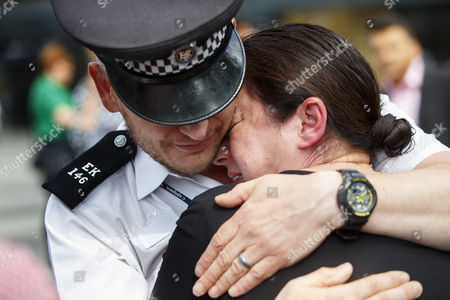 Survivor Gill Hicks and Constable Andy Maxwell reflecting outside King's Cross station as they promote 'Walk Together'