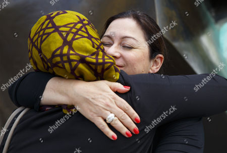 Survivor Gill Hicks hugging Sughra Ahmed as they promote 'Walk Together'