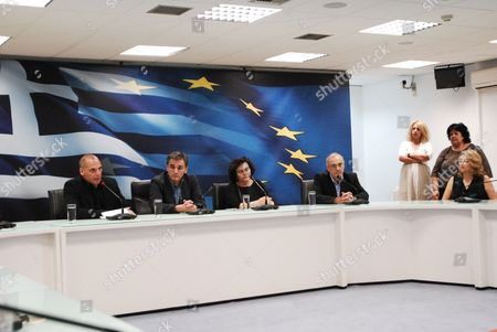 Stock Image of Yanis Varoufakis, former Minister of Finance and Euclid Tsakalotos, the new Minister of Finance together with the Deputy Ministers Nadia Valavani and Dimitris Mardas
