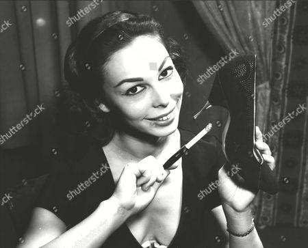 Editorial image of Hazel Graeme (22) Ex-dior Fashion Model & Jazz Singer. Displaying Shoes At Fashion Footwear Exhibition In London. Box 0593 24062015 00210a.jpg.