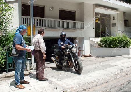Yanis Varoufakis leaves home on his Yamaha motorbike after announcing his resignation
