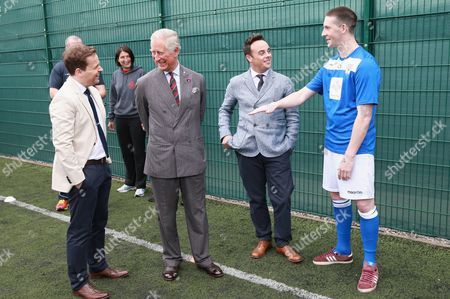 Prince Charles, Anthony McPartlin and Declan Donnelly (who are supporters of the Prince's Trust) chat to inmate Thomas Lloyd who is taking part in a 'Get Started with Football' programme run by the Prince's Trust