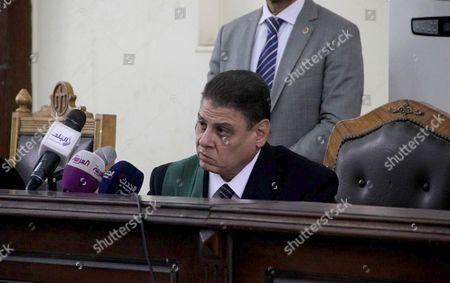 Stock Image of An Egyptian Judge attends the trial of Egyptian radical Islamist Mohammed al-Zawahiri, the brother of Al-Qaeda chief Ayman al-Zawahiri with 68 other defendants