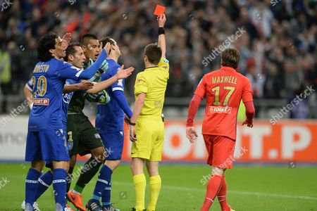 French referee's Benoit Bastien gives a red card to the Bastia player's Sebastien Squillaci during the Football League Cup Final - Paris Saint Germain vs SC Bastia at Stade de France, Saint-Denis, France  - 11/04/2015/JEFFROYGUY_psg_bastia_37/Credit:JEFFROY GUY/SIPA/1504121156