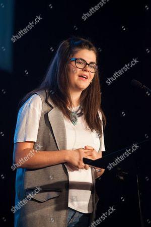 Stock Photo of Megan Dunn speaking at the Macron Stadium