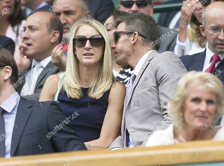 Stock Photo of Olympic Athlete Paula radcliffe and Gary Lough in the Royal Box on Centre Court, 2015 Wimbledon Tennis Championships,  A.E.L.T.C, London, Britain.