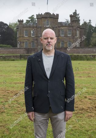 T in the Park founder Geoff Ellis, with Strathallan Castle in the background.