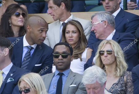 Ex-Footballer Thiery Henry talks to Sir Alex Ferguson in the Royal box on Centre Court with Ms Andrea Rajacic, 2015 Wimbledon Tennis Championships,  A.E.L.T.C, London, Britain.