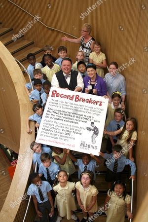 Craig Glenday, Editor of the Guiness Book of World Records with Under Secretary of State & Minister for Intellectual Property Baroness Neville-Rolfe and The Class of Year 3 of St.Johns Catholic School.
