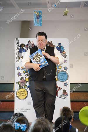 Craig Glenday the editor of the Guiness World Records Book and his team present 'My Pledge to be a Record Breaker' to children of the third year of St. Johns Catholic School, at at Record Breakers - Hosted by Canada Water Library and the Reading Agency.