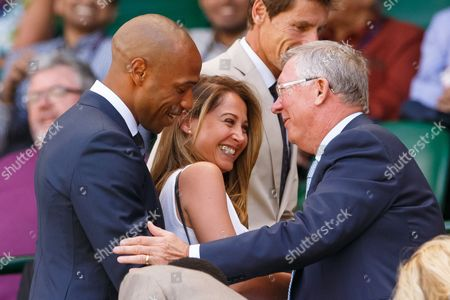 Footballer Thierry Henry and Ms Andrea Rajacic with Sir Alex Ferguson