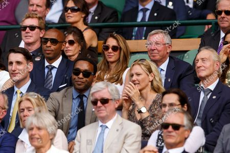 Footballer Thierry Henry and Ms Andrea Rajacic watches from the Royal Box along side Sir Alex Ferguson and Actor Chiwetel Ejiofor and his guest Ms Jennifer Barrons
