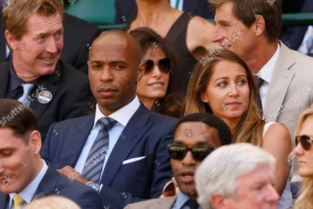 Footballer Thierry Henry and Ms Andrea Rajacic watch from the royal box