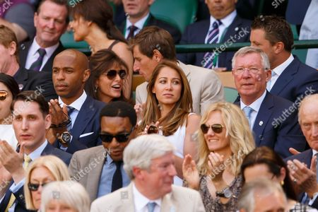 Footballer Thierry Henry and Ms Andrea Rajacic with Sir Alex Ferguson watch from the royal box