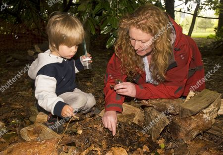 Celebrity TV gardener Charlie Dimmock (TVs Ground Force) searching for 'bugs' during a Grow For It nature awareness day for children, Hindhead, Surrey