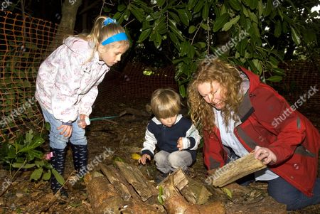 Stock Photo of Celebrity TV gardener Charlie Dimmock (TVs Ground Force) searching for 'bugs' during a Grow For It nature awareness day for children, Hindhead, Surrey