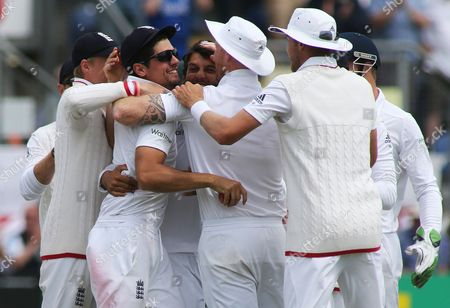England Captain Alistair Cook celebrates catching out Brad Haddin of Australia off the bowling of Moeen Ali.